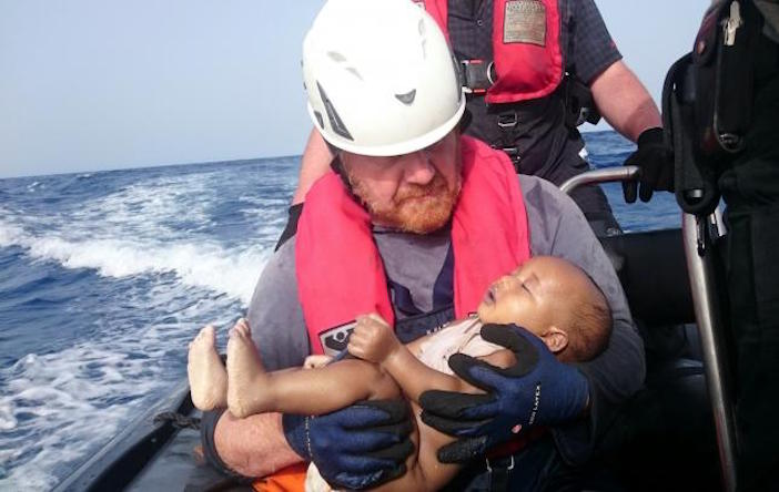 A German rescuer from Sea-Watch holds a drowned refugee baby, off the Libyan coast May 27, 2016. Photo by Christian Buettner/Eikon Nord GmbH Germany/Handout via Sea-Watch