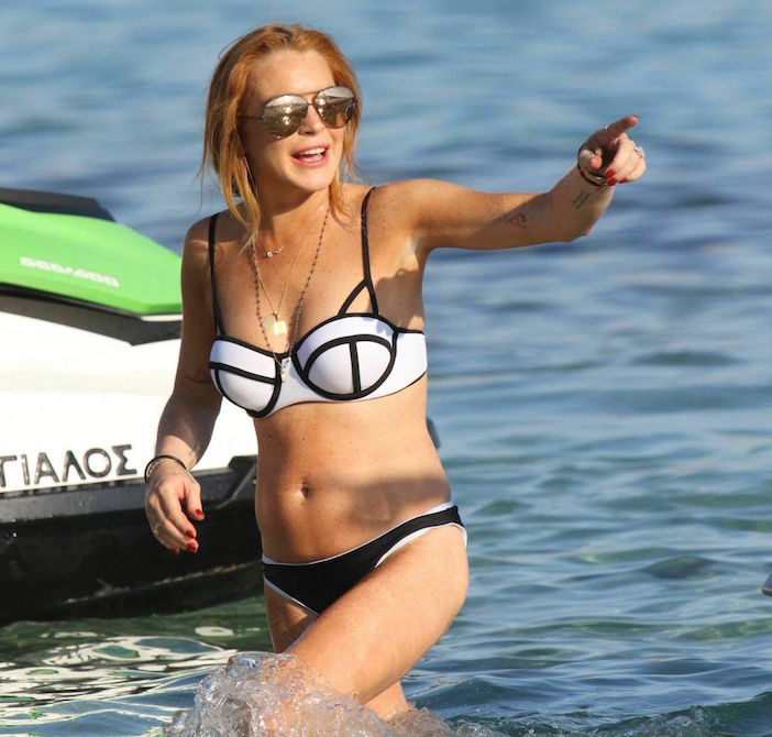 Lindsay loves Mykonos. Here she is frolicking on the beach in 2015.
