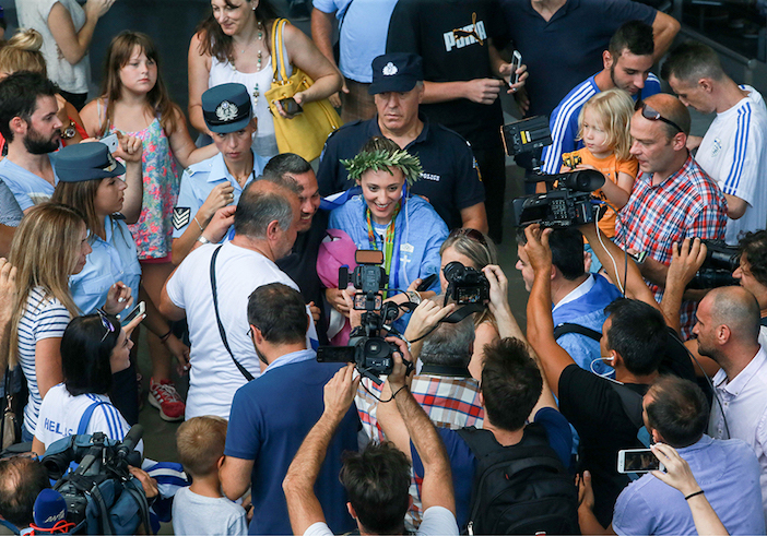 Mobbed by family, friends and reporters upon her arrival in Drama.