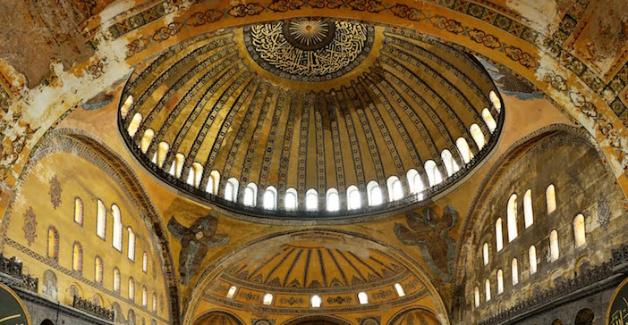 Santiago Calatrava was inspired by Hagia Sophia in Constantinople with its 40 ribs, buffered by windows that give the dome a feeling of floating in the air above the basilica.