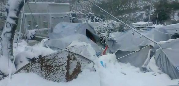 Greek Navy Sends Vessel to Temporarily House Freezing Refugees on Lesvos