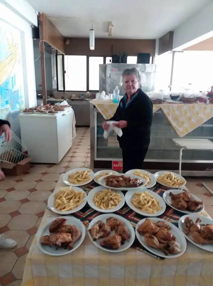 Maria preparing holiday meals at her restaurant on December 30, 2016. Photos by Ulrika Skogby via Facebook