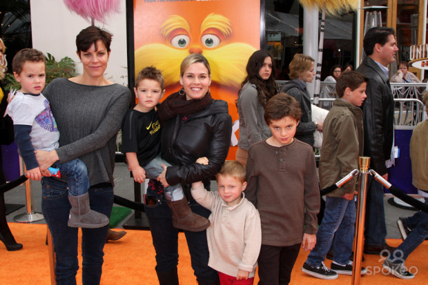 Cat Cora (center) with her wife Jennifer and their four boys