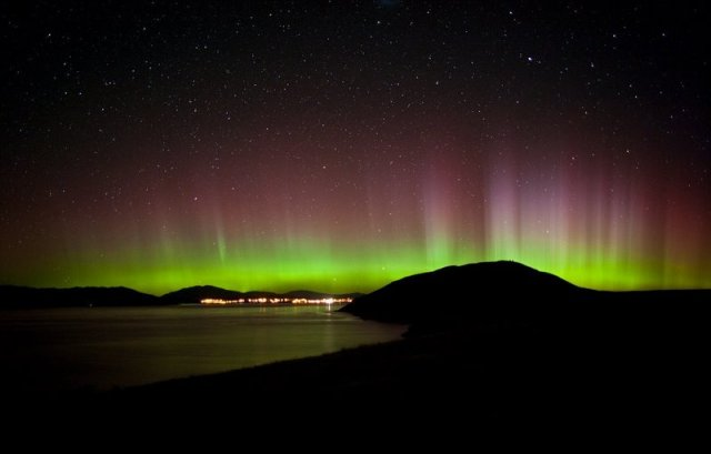 Aurora Australis reflecting in Lake Tekapo, with Tekapo and Mt John