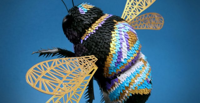 Deze prachtige dieren zijn gemaakt van honderden stukjes papier