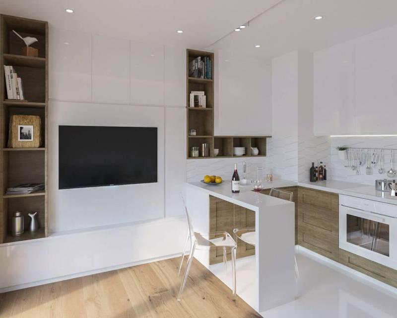 Białe ściany, drewnopodobna, jasna podłoga iefektowna struktura nabiałych płytkach – tociekawy pomysł nanowoczesną przestrzeń.
