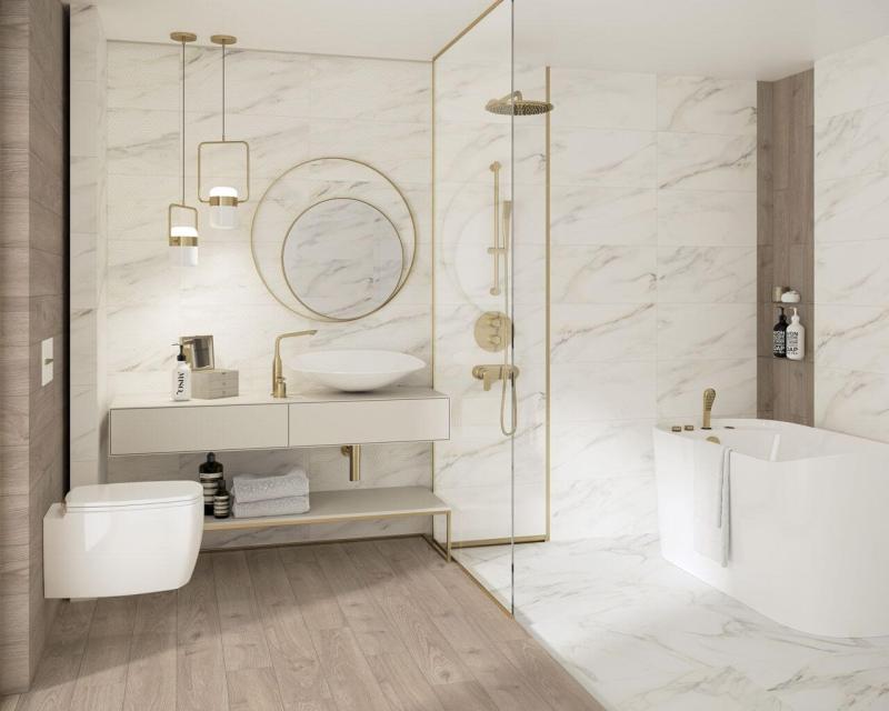 Motyw marmuru idrewna wnowoczesnej łazience będzie świetnie współgrał zezłotymi dekoracjami.