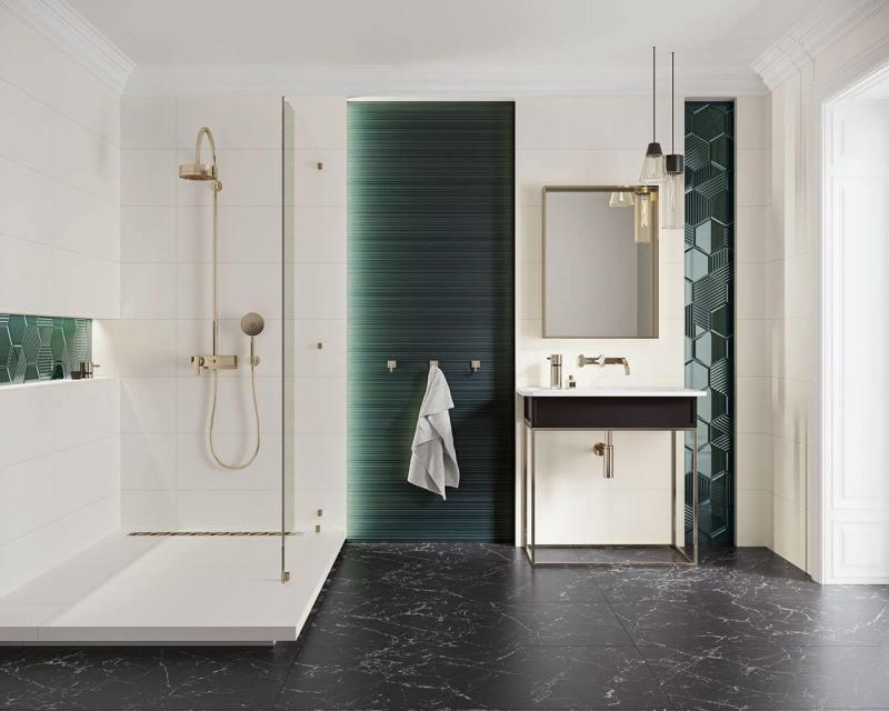 Błyszcząca powierzchnia płytek wpołączeniu zciekawym kształtem, kolorem istrukturą tworzy piękną dekorację włazience.