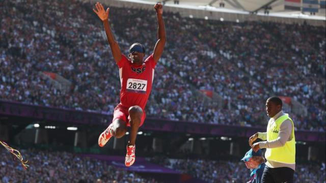 Lex Gillette in the air after jumping in the long jump event at London 2012