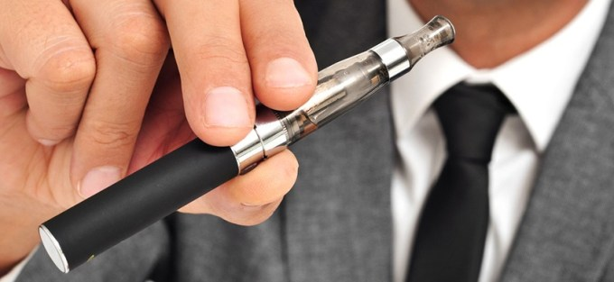 man holding Vaping Pen