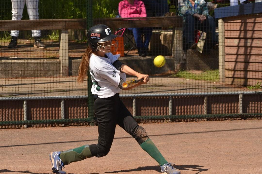 girls playing softball