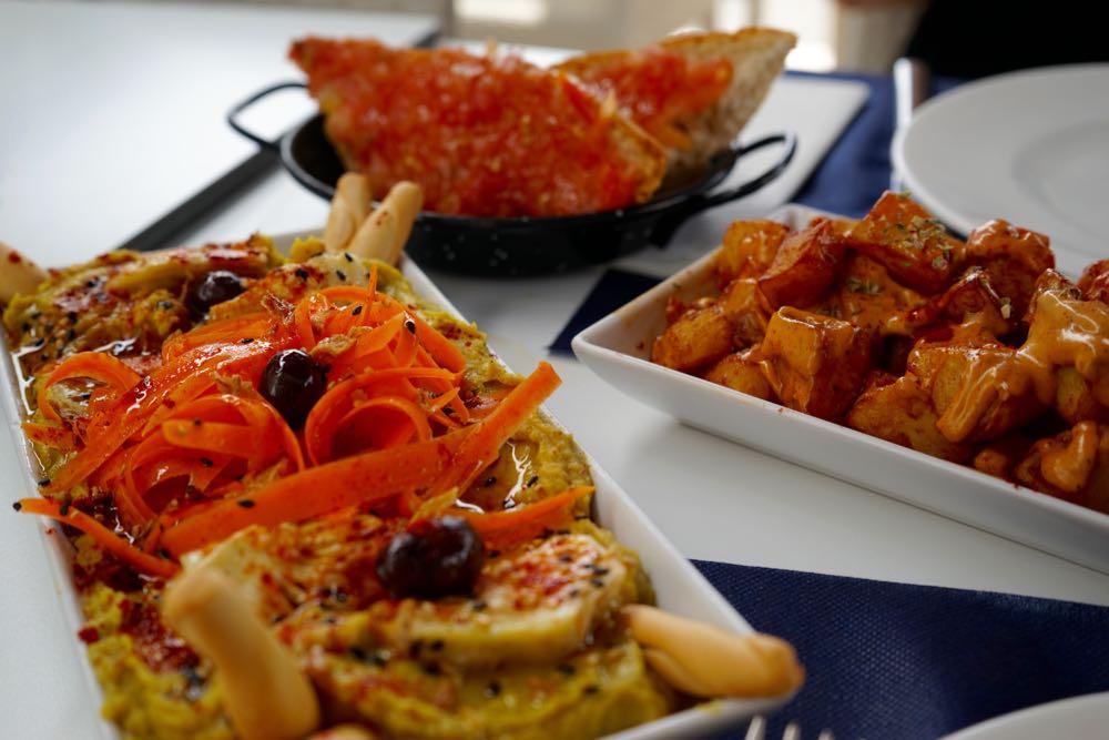 Hummus, tomato bread and patas bravas