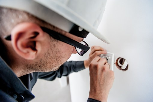 electrician fixing a wall switch
