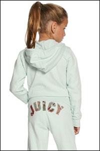 little girl wearing Juicy tracksuit
