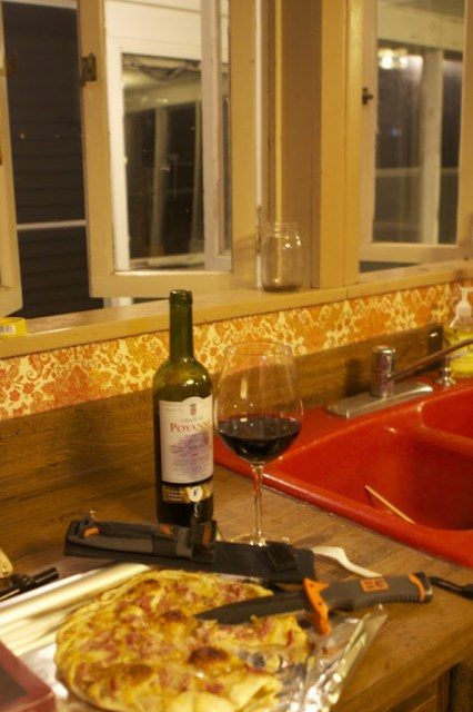 view of pizza and wine on kitchen counter