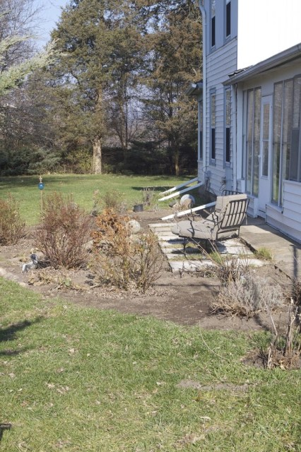 view of outdoor porch area behind a house