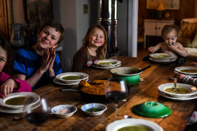 Family Eating Roasted Poblano Pepper Soup with Einkorn Cornbread