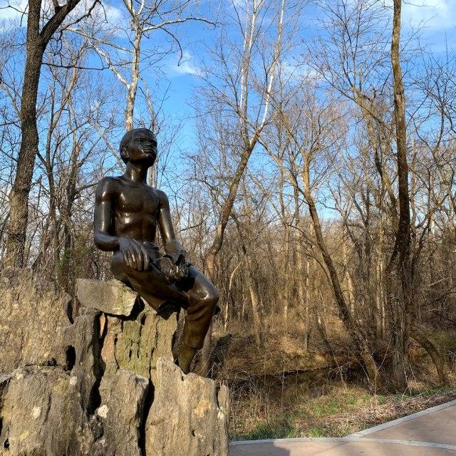 Boy Carver Statue