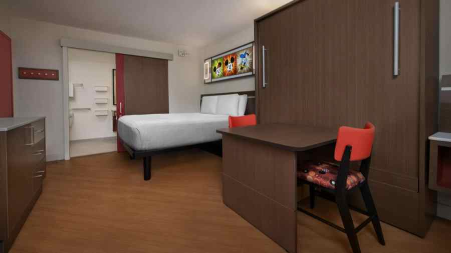 Room with one queen bed and desk
