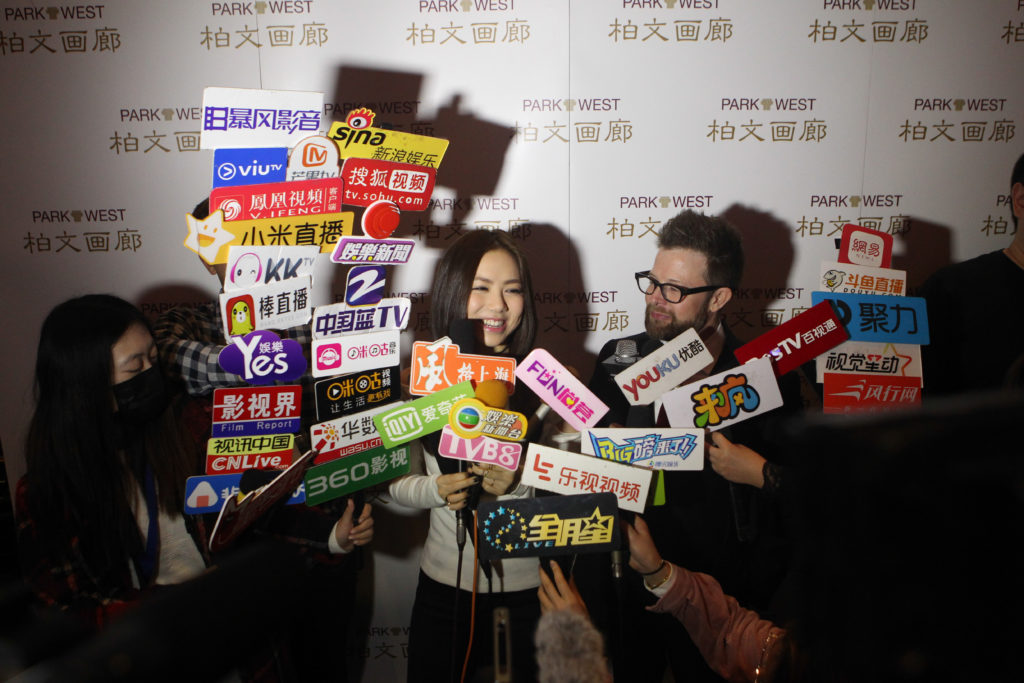 G.E.M. speaks to the media at Park West Gallery unveiling of Peter Max portrait.