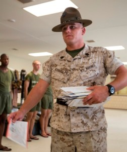 The senior drill instructor of Platoon 2080, Fox Company, 2nd Recruit Training Battalion, distributes mail to his recruits at the end of the training day. Mail is distributed at the end of each training day Monday through Saturday. (Photo by Cpl. David Bessey)