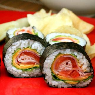 'Club Sandwich' Sushi Roll. Wasabi mayo, butter lettuce, cheddar cheese, ham, tomato and turkey.