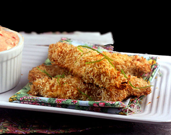 Crunchy Coconut Key Lime Oven Fried Chicken Sticks (or chunks) with Spicy Greek Yogurt Dipping Sauce. So crunchy that it tastes deep-fried!