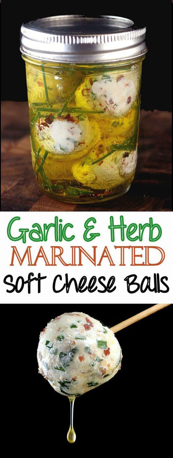 Cheeseballs! Creamy balls of soft cheese, like chevre or cream cheese, loaded with garlic, herbs and a little chili flake, then marinated in olive oil with even more garlic and herbs! #cheeseballs #goatcheese #softcheese #garlic #herbs #redpepperflakes #lemonzest #marinatedcheese