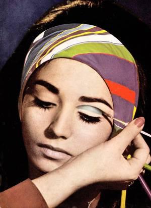 Model applying eyeshadow - 1970s