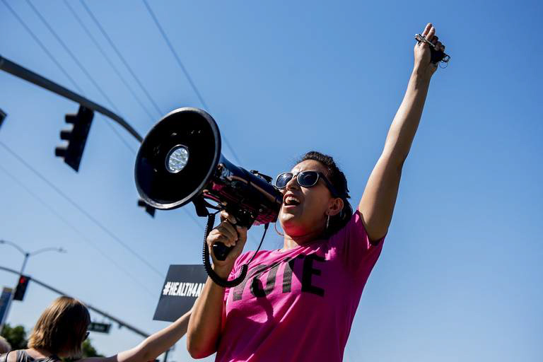 """Sol Rivas speaking at a community march and rally in Merced, California, photo credit should go to """"Building Healthy Communities Merced"""
