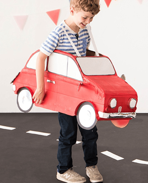 How to make a DIY Kids Car Costume - do you have any opened Amazon smile boxes laying around? Perfect. Grab that box and head over to see how to make this super cute kids Halloween costume using a box.