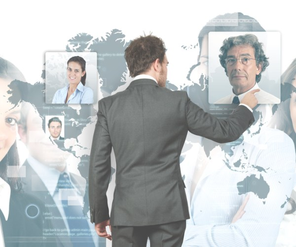 Futuristic conference among businessmen on viartual screen