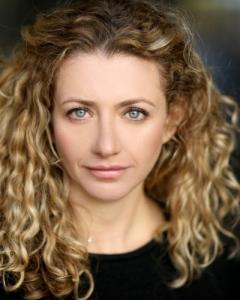 Louisa Clein as LIORA (LEE) KAUFMANN