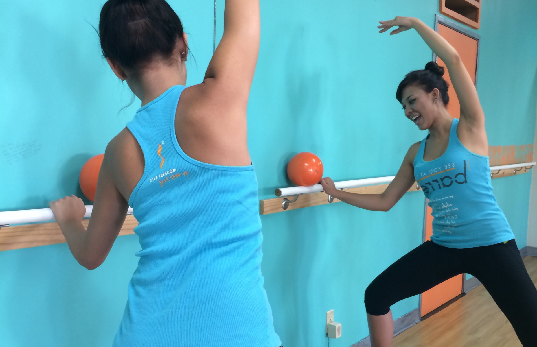 Passion Barre Pose: Plié in Second with a side bend