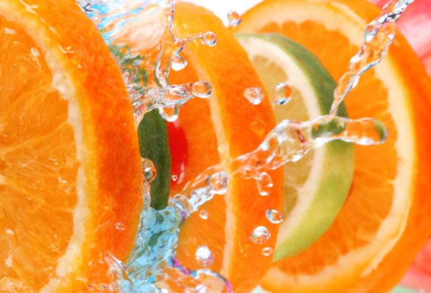 refreshing shot of sliced fruit and water splash from passion barre
