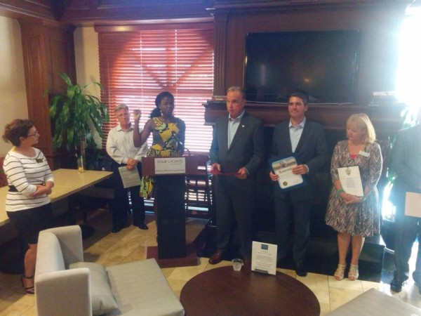 Passion Barre speaks to chamber members and dignitaries at RC Chamber New member reception