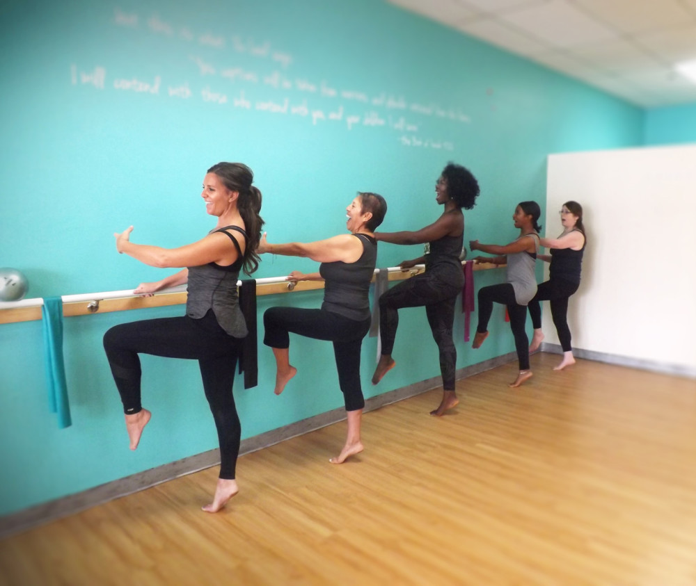 Elated ladies working out at Passion Barre