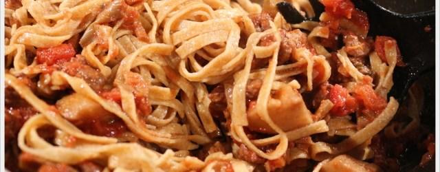 ricetta pasta ragù di agnello e carciofi