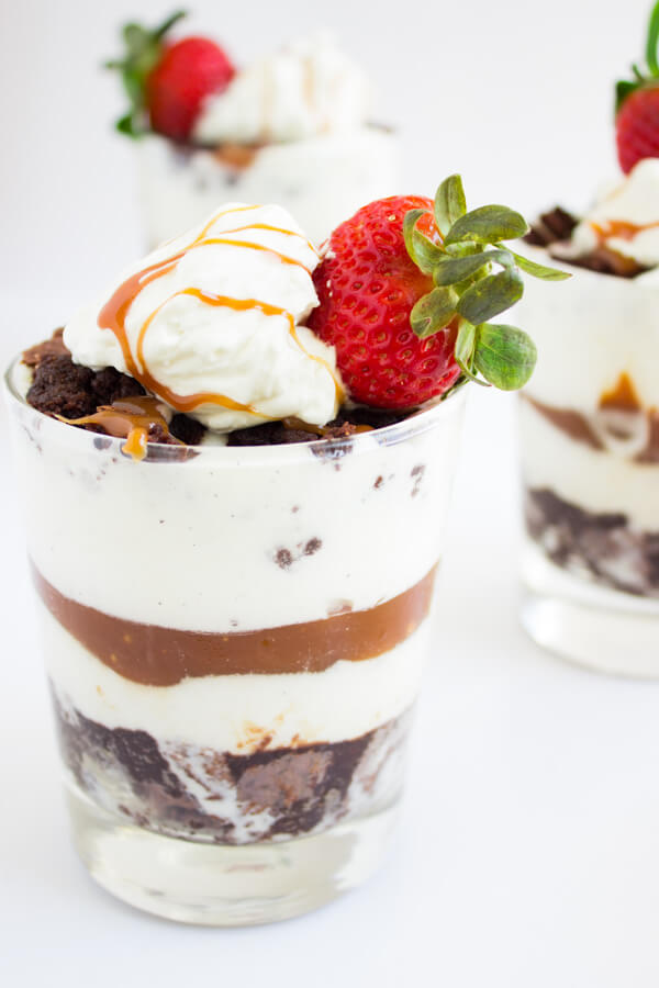 Salted Caramel Brownie Ice Cream Parfaits   Dessert   Gluten Free Recipe   Layers of warm brownie, ice cream, and salted caramel topped with homemade whipped cream and strawberries are what these dessert parfait dreams are made of.   passmesometasty.com