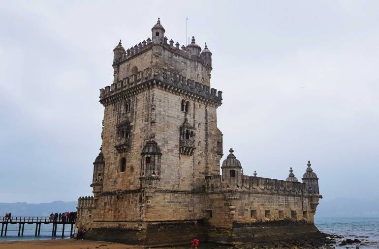Things to do in Lisbon: The Tower of Belem standing guard beside the River Tagus.