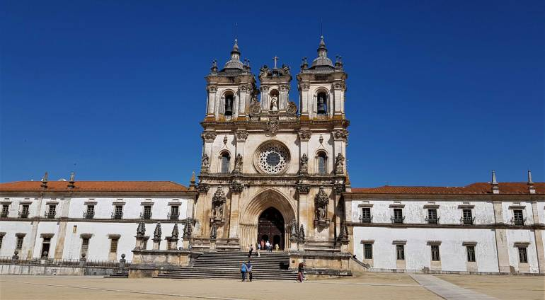 UNESCO sites. Front view of the Alcobaça monastery with its imposing bell towers.