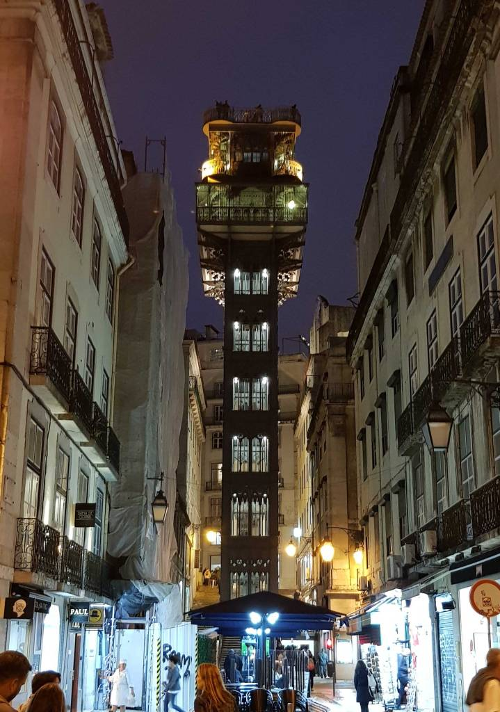 Things to do in Lisbon: The Santa Justa Elevator lit up at night.