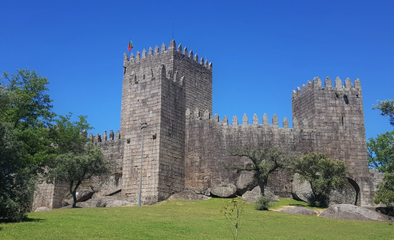 Thegrey,  towering walls of Guimaraes castle