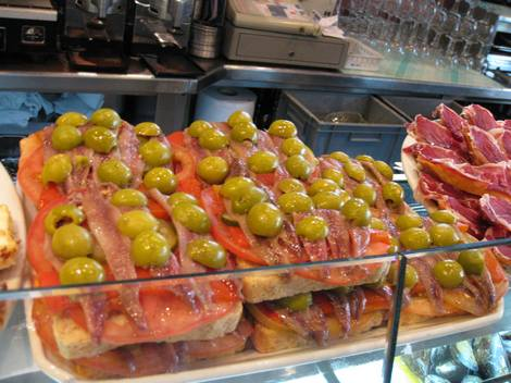 Olives and anchovies and tomatoes oh my