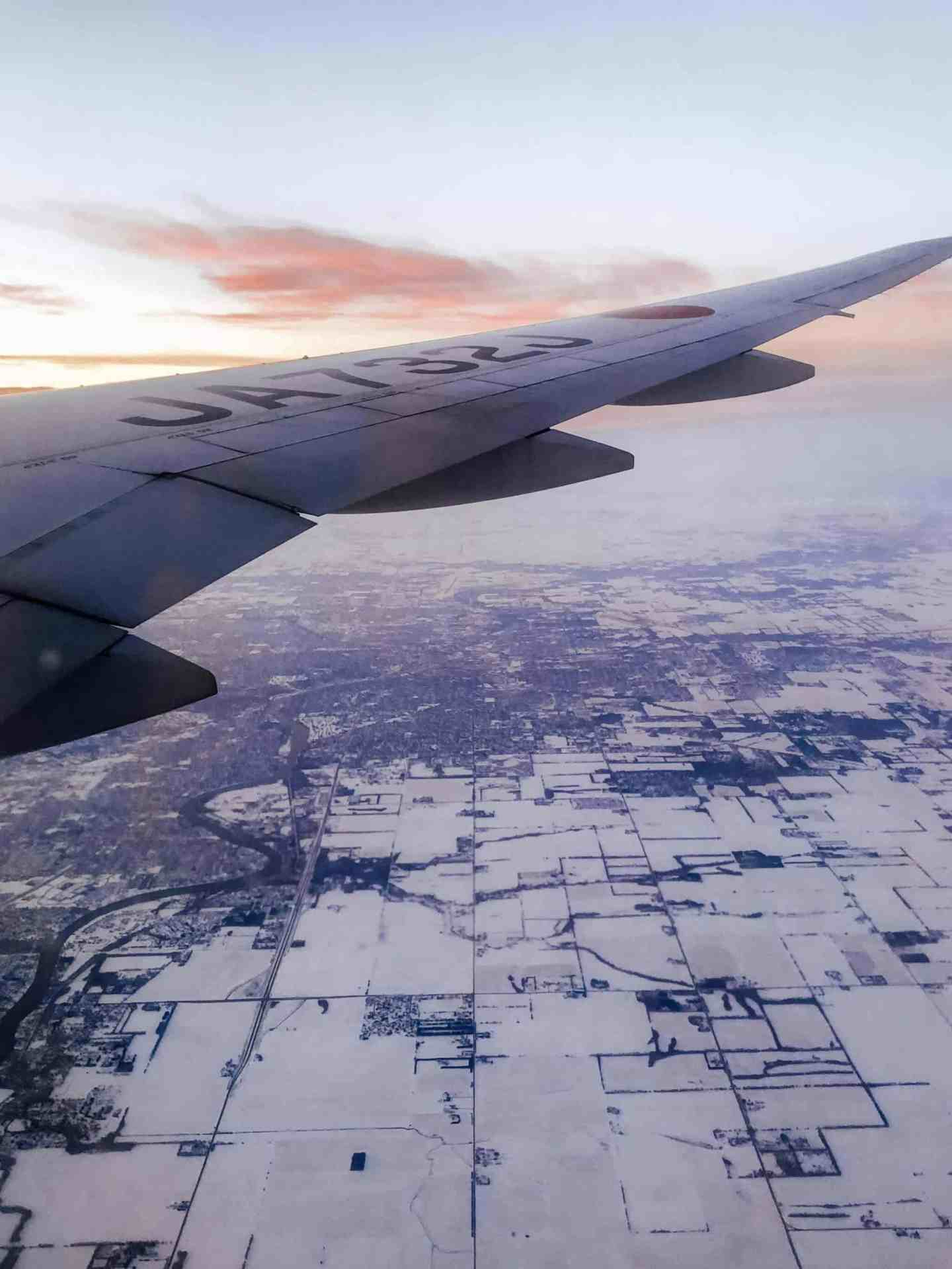 Airplane flying over snow