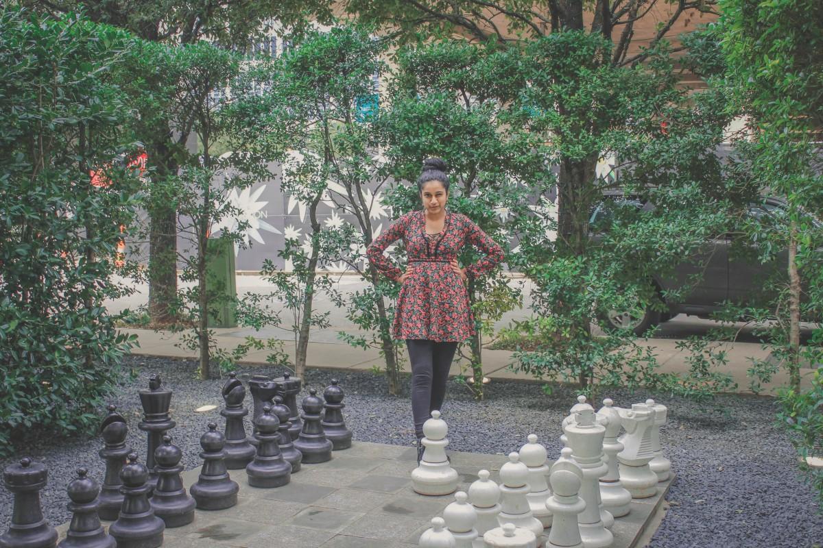 Anshula at a chess board in Samurai Park in Dallas