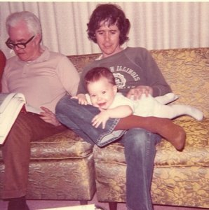 Left to right: My grandfather, My dad, Some Random Baby (me), Ugliest Couch Ever