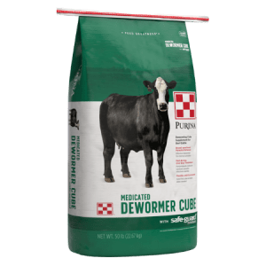 Green and white feed bag. Black cow. Purina Safe-Guard Cattle Cube Dewormer 50-lb bag. Easy, safe and convenient method to worm beef and dairy cattle.