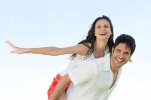 Happy joyful couple enjoy the freedom of the summer