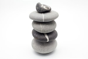 group of poised stones on white